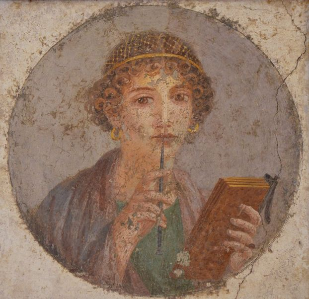 Fresco_showing_a_woman_so-called_Sappho_holding_writing_implements,_from_Pompeii,_Naples_National_Archaeological_Museum_(14842101892)